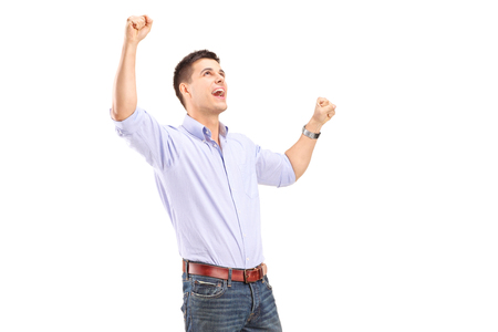 gesturing: Happy young man gesturing joy isolated on white background