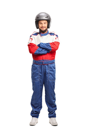 car race: Full length portrait of a young male car racer with a gray helmet isolated on white background Stock Photo