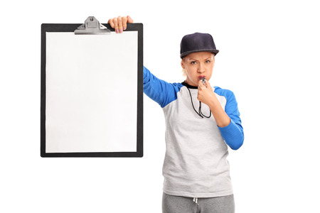sports coach: Angry female sports coach holding a clipboard with a blank paper on it and blowing a whistle isolated on white background
