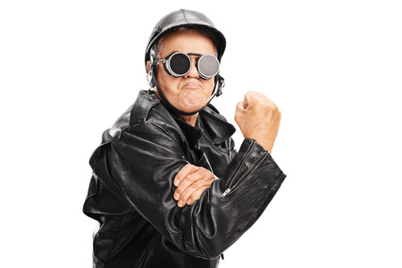 cocky: Cocky senior motorcyclist gesturing with his hand with gripped fist isolated on white background