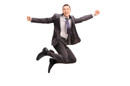 midair: Full length portrait of an overjoyed businessman jumping and gesturing happiness shot in mid-air isolated on white background