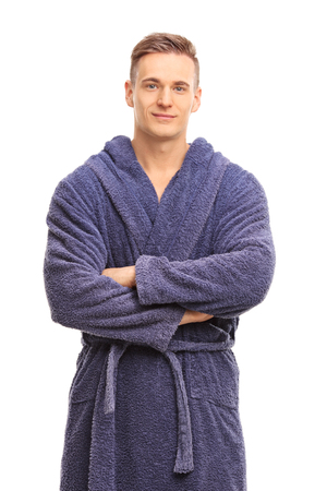 bath robes: Vertical shot of a cheerful young man in a blue bathrobe smiling and looking at the camera isolated on white background