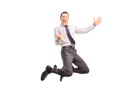 white men: Full length portrait of a delighted businessman jumping and gesturing success shot in mid-air isolated on white background Stock Photo