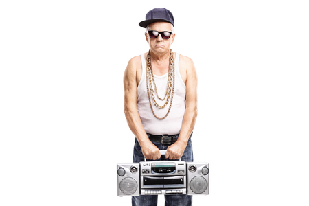 ghetto: Mature rapper holding a ghetto blaster and looking at the camera isolated on white background