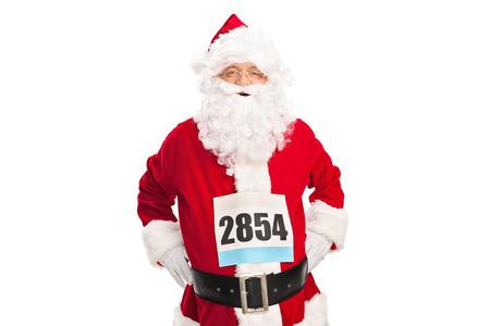 santa claus: Estudio tirado de un hombre mayor en traje de Santa Claus con un n�mero de dorsal en el pecho aislado en fondo blanco