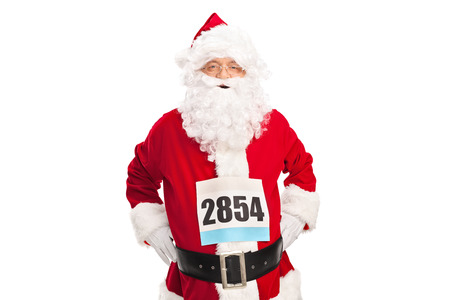 caucasian race: Studio shot of a senior man in Santa Claus costume with a race number on his chest isolated on white background