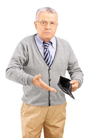 man sad: Vertical studio shot of a mature man holding an empty wallet and pointing towards it isolated on white background