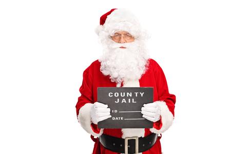 carcel: Estudio tirado de un criminal de Santa Claus posando para una foto policial con un tablero negro en la mano aisladas sobre fondo blanco Foto de archivo