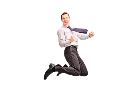 overjoyed: Studio shot of an overjoyed businessman jumping and gesturing happiness shot in mid-air isolated on white background
