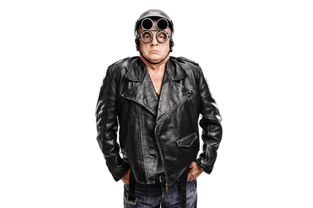 grumpy old man: Grumpy mature motorcyclist posing in a black leather jacket with a helmet and goggles isolated on white background