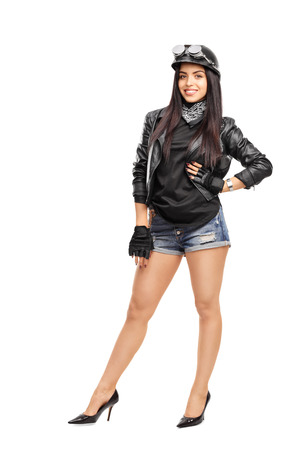 sexy girl posing: Full length portrait of a young female biker in black leather jacket posing isolated on white background Stock Photo