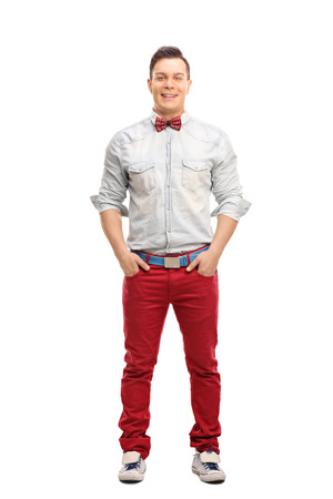 red jeans: Full length portrait of a young fashionable man posing in red jeans isolated on white background Stock Photo