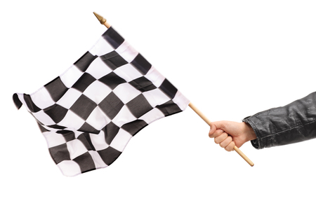 checker flag: Studio shot of a male hand waving a checkered race flag isolated on white background