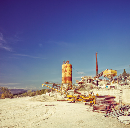 gravel pit: Gear and machines at a gravel pit shot on a clear sunny day shot with tilt and shift lens