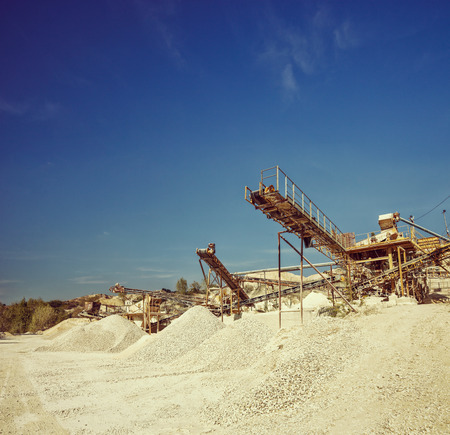 gravel pit: Conveyor belts and machinery at a gravel pit shot on a clear sunny day shot with tilt and shift lens