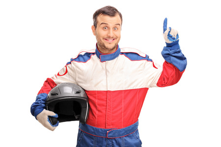 aha: Young male car racer holding a helmet and having an idea isolated on white background