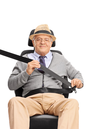 car isolated: Senior gentleman sitting on the passenger seat fastened with a seatbelt and looking at the camera isolated on white background Stock Photo