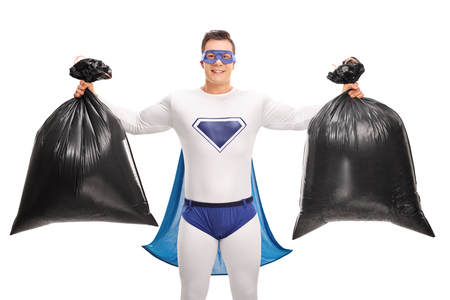 dumping: Superhero in a white and blue costume holding two trash bags and looking at the camera isolated on white background