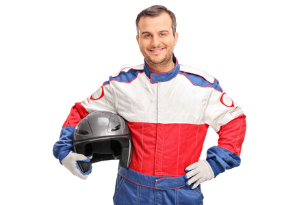 car isolated: Studio shot of a young car racer holding a gray helmet and looking at the camera isolated on white background
