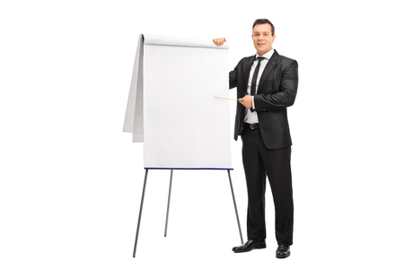 presentation board: Young businessman pointing on a presentation board with a wooden stick isolated on white background