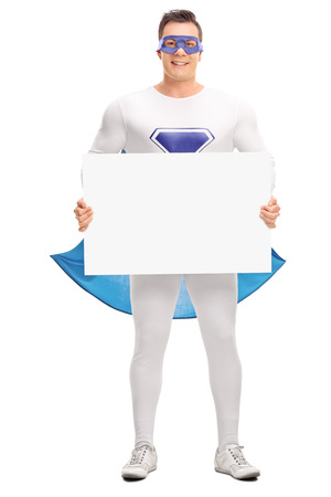 rescuer: Full length portrait of a male superhero holding a blank signboard and looking at the camera isolated on white background