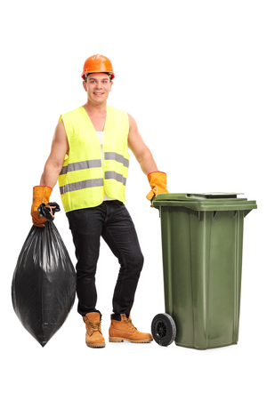 garbage can: Full length portrait of a young male waster collector emptying a trash can isolated on white background Stock Photo
