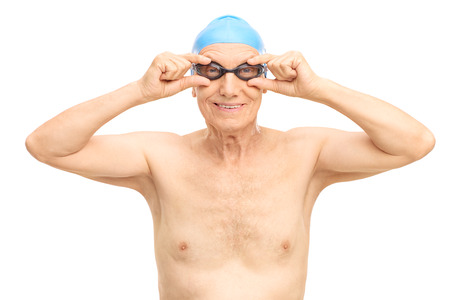 swimming goggles: Studio shot of a senior man with a blue swim cap and black swimming goggles isolated on white background Stock Photo