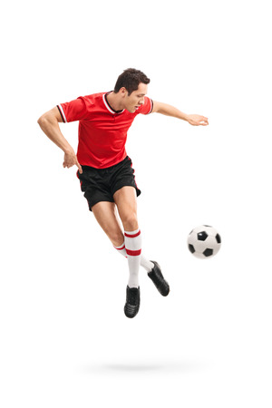 flick: Full length portrait of a skillful football player performing a rainbow flick shot in mid-air isolated on white background
