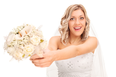 to toss: Young excited bride preparing to toss the wedding flower isolated on white background