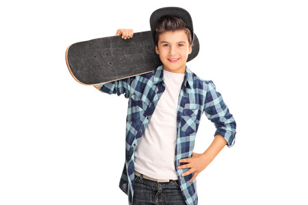 shoulder carrying: Cool little boy carrying a skateboard over his shoulder and looking at the camera isolated on white background Stock Photo