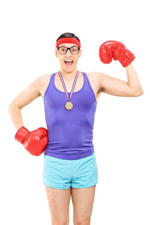 geeky: Vertical shot of a geeky guy with red boxing gloves wearing a medal isolated on white background