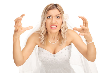 strangling: Angry bride threatening to strangle someone and looking at the camera isolated on white background