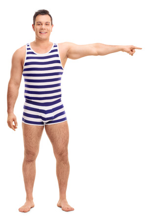 muscle guy: Full length portrait of a young man in a striped underwear pointing right with his hand isolated on white background Stock Photo