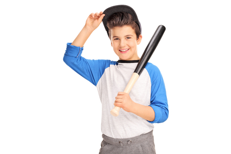 baseball hat: Little boy holding a baseball bat and looking at the camera isolated on white background