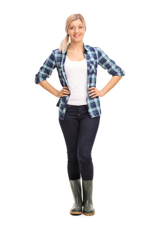 redneck: Full length portrait of a young woman in blue checkered shirt and green rubber boots isolated on white background