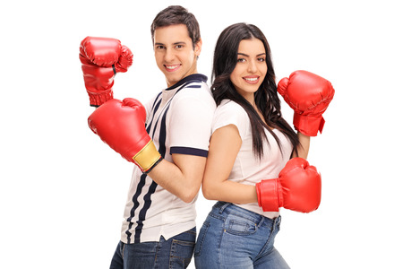 boy boxing: Young man and woman with boxing gloves posing together isolated on white background Stock Photo