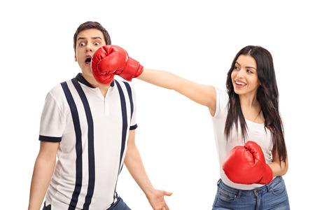 boy boxing: Cheerful woman punching her boyfriend with boxing gloves isolated on white background Stock Photo