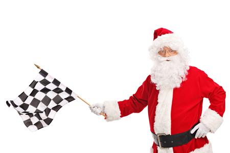 bandera carrera: Estudio tirado de Santa Claus con una bandera a cuadros la carrera y mirando a la cámara aislada en el fondo blanco Foto de archivo