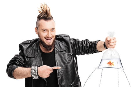 Evil male punk holding a goldfish in a bag with holes poked in it and the water leaking isolated on white background Banque d'images