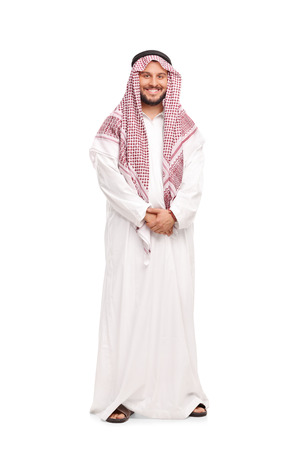 a white robe: Full length portrait of a young Arab in a white robe and a red veil isolated on white background