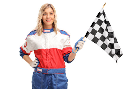 racer flag: Young female car racer waving a checkered race flag and looking at the camera isolated on white background