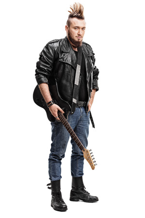 rock guitarist: Full length portrait of a punk rock guitarist holding an electric guitar isolated on white background Stock Photo
