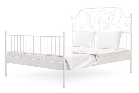 king size: Studio shot of a large white bed with a vintage decoration isolated on white background