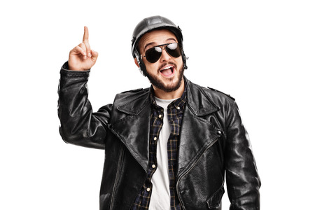 biker man: Studio shot of a young male biker having an idea and looking at the camera isolated on white background Stock Photo
