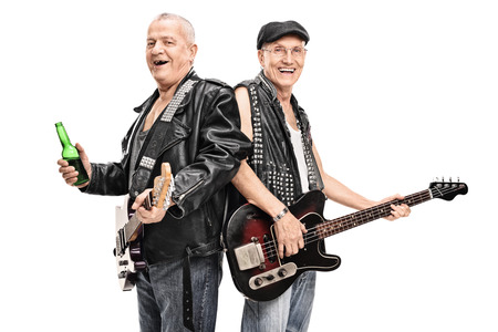 bass player: Senior male punk rock bass player and guitarist posing together isolated on white background Stock Photo