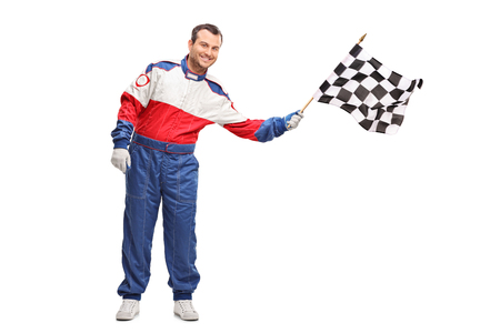racer flag: Studio shot of a young male car racer waving a checkered race flag isolated on white background Stock Photo