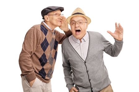 Senior man whispering something to his friend and laughing together isolated on white background Reklamní fotografie - 52452203