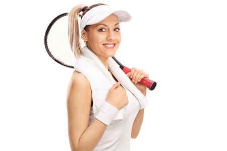 payer: Studio shot of a young female tennis payer holding a racket isolated on white background