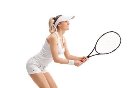 woman profile: Profile shot of a young blond woman playing tennis isolated on white background Stock Photo