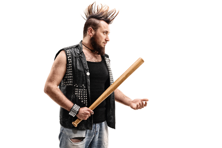 threatening: Violent punk rocker holding a baseball bat and threatening someone isolated on white background
